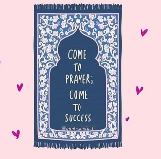 An illustration of a navy blue prayer rug with light pink floral patterns. In the center of the rug it reads,